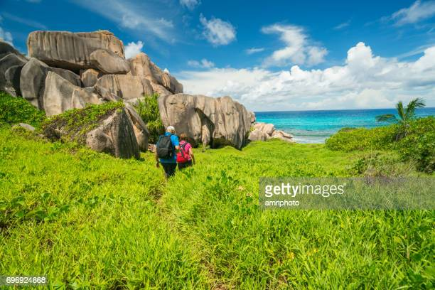 seniors taking on the world, hiking on tropical island - la digue island stock pictures, royalty-free photos & images