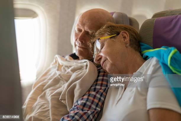 Seniors Taking on the World, sleeping in plane