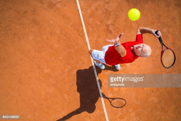 seniors taking on the world, tennis service from above - tennis player stock pictures, royalty-free photos & images