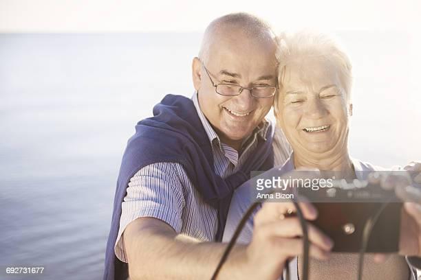 Seniors taking selfie on the beach. Gdansk, Poland
