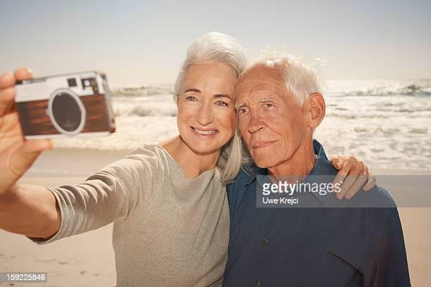 Seniors taking self-portrait with smart phone