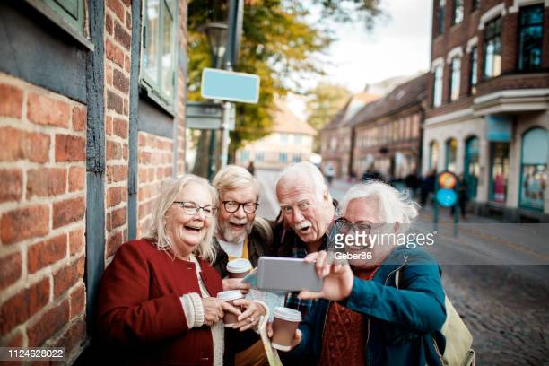 seniors using a phone - retirement stock pictures, royalty-free photos & images