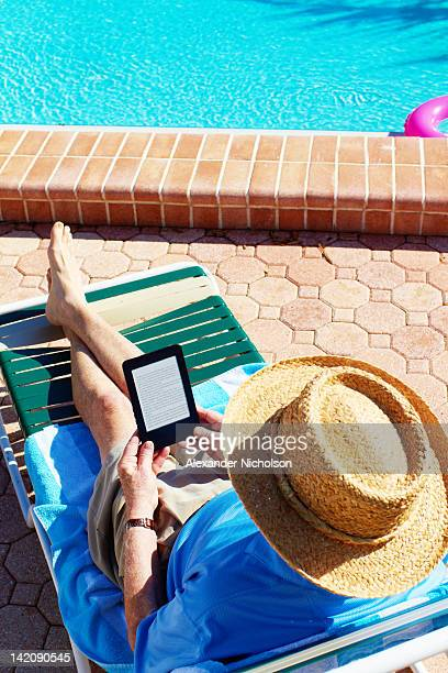 seniors using digital device - only senior men stock pictures, royalty-free photos & images