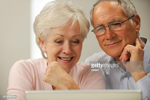 seniors using laptop