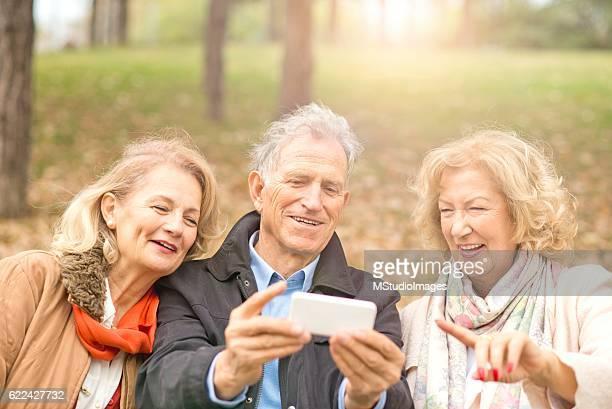 Seniors using smartphone.