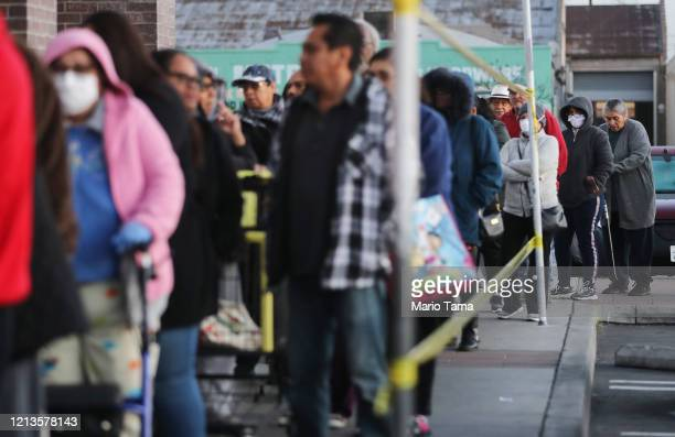 Seniors wait in line to shop for groceries during special hours open to seniors and the disabled at Northgate Gonzalez Market a Hispanic specialty...