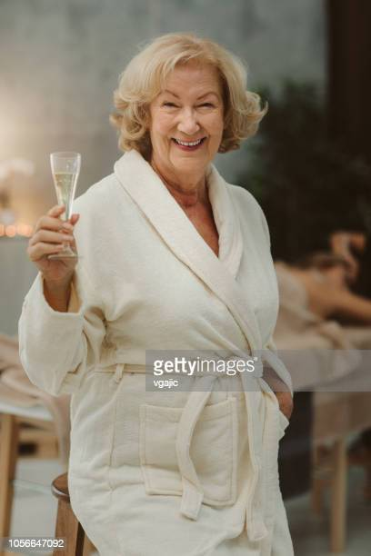 seniors woman in spa - bathrobe stock pictures, royalty-free photos & images