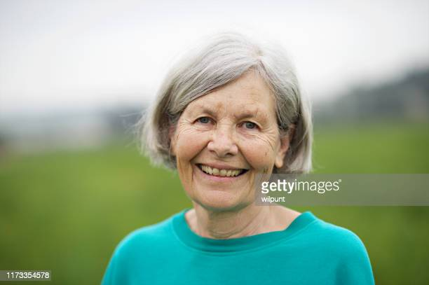 seniors woman portrait outdoors 70-79 years - 70 79 years stock pictures, royalty-free photos & images