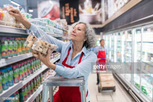 seniors working in supermarket - assistant stock pictures, royalty-free photos & images