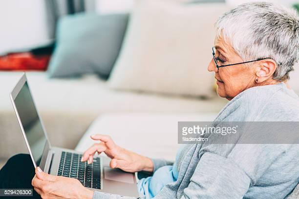 Seniour woman using new technology