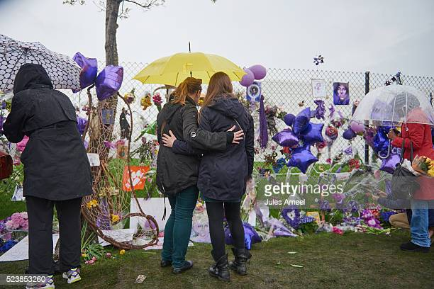 Senja Lopac and Lorrie Hammer embrace in front of the memorial outside Paisley Park on April 24 2016 in Chanhassen Minnesota Prince died on April 21...