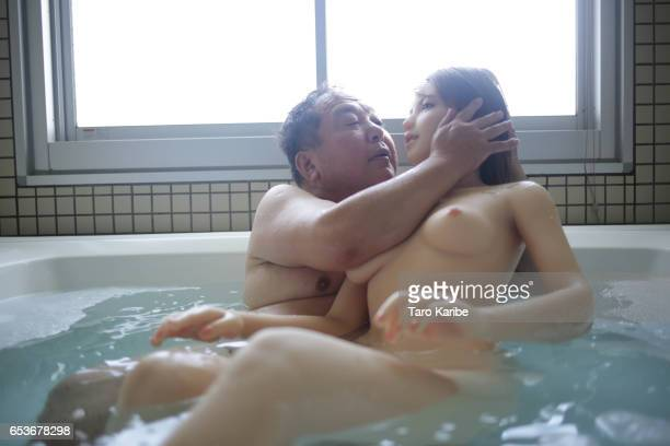 Senji Nakajima taking bath with his love doll Saori at the love hotel on Septermber 27 2016 in Sagamihara Japan Senji Nakajima 60 years old lives...