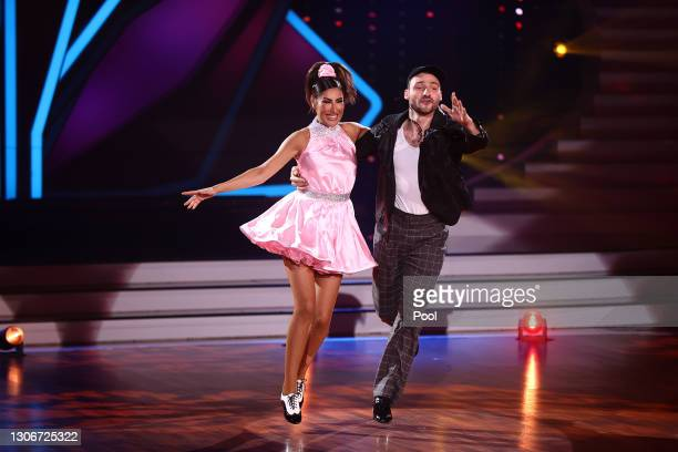 """Senna Gammour and Robert Beitsch perform on stage during the 2nd show of the 14th season of the television competition """"Let's Dance"""" on March 12,..."""