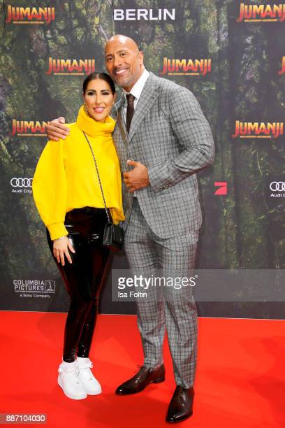 Senna Gammour and US actor Dwayne Johnson attend the German premiere of 'Jumanji Willkommen im Dschungel' at Sony Centre on December 6 2017 in Berlin...