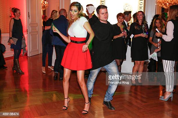Senna Guemmour and Rocco Stark dance at the Deichmann Shoe Step of the Year 2014 on November 17 2014 in Hamburg Germany
