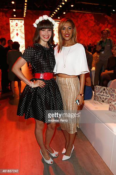 Senna Guemmour and Wanda Badwal attend the Lena Hoschek show during the MercedesBenz Fashion Week Spring/Summer 2015 at Erika Hess Eisstadion on July...