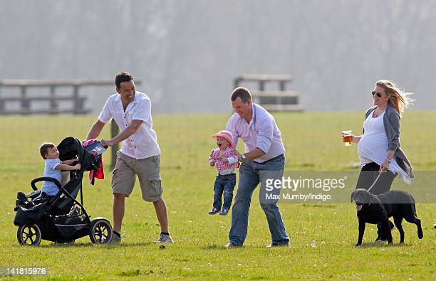 Senna Lewis is pushed in her pushchair by her father Gary Lewis Savanah Phillips being carried by her father Peter Phillips and heavily pregnant...