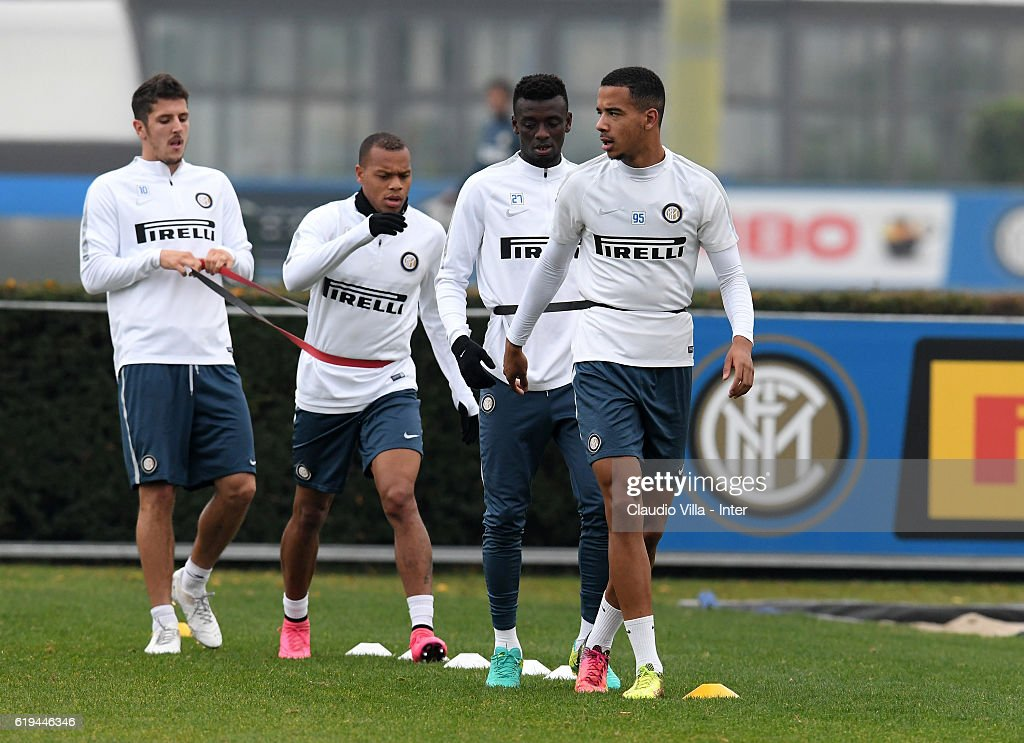Senna Miangue of FC Internazionale (R) looks on during the FC Internazionale training session at the club's training ground at Appiano Gentile on October 31, 2016 in Como, Italy.