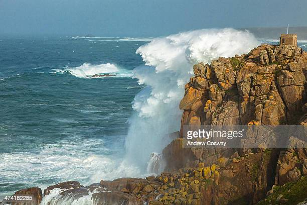 Sennon Cove during the storms that hit the South West of England to capture the breaking waves clashing with the rugged cliffs of the Cornish...