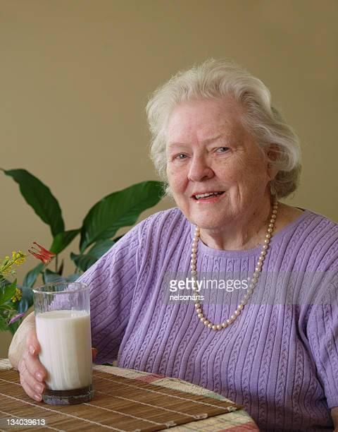 Senoir woman with milk