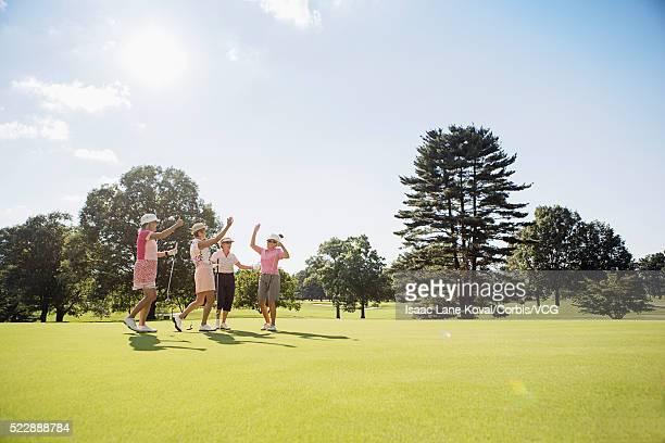 senor female golfers cheering on golf course - 女子 ゴルフ ストックフォトと画像