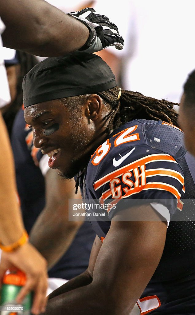 Senorise Perry #32 of the Chicago Bears gets a pat on the head while sitting on the bench after running for a touchdown against the Miami Dolphins during a preseason game at Soldier Field on August 13, 2015 in Chicago, Illinois. The Bears defeated the Dolphins 27-10.