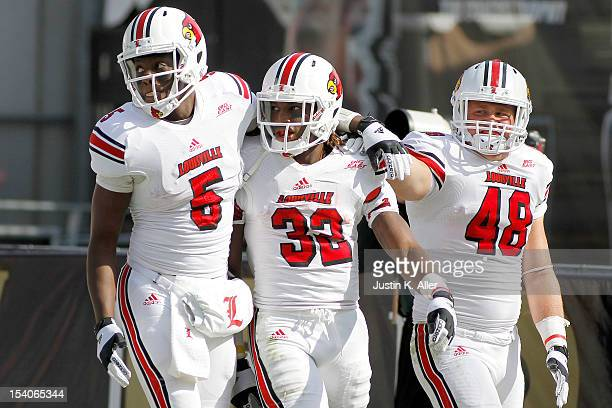 Senorise Perry of the Louisville Cardinals celebrates after rushing for a 59yard touchdown in the fourth quarter against the Pittsburgh Panthers...