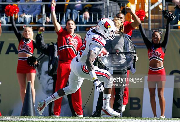 Senorise Perry of the Louisville Cardinals rushes for a sixyard touchdown in the first quarter against the Pittsburgh Panthers during the game on...