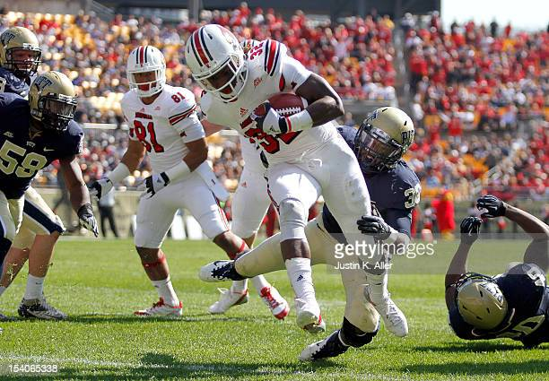 Senorise Perry of the Louisville Cardinals rushes for a thirdquarter touchdown against the Pittsburgh Panthers during the game on October 13 2012 at...