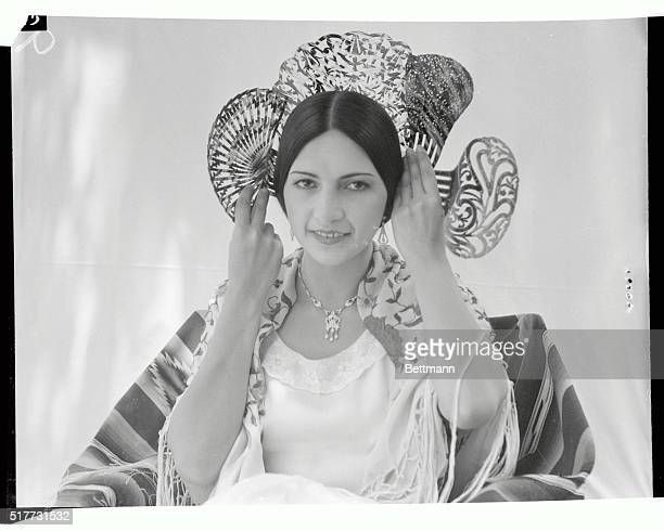 Senorita Isabel Arevalo one of the descendents of the oldest Spanish families to settle in California is shown wearing one of the four combs that...