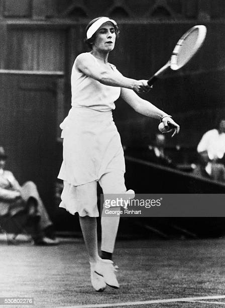 Senorita Lily d'Alvarez of Spain presented this unusual shot as she defeated Mrs Lycett of Great Britain in the Women's Singles at Wimbledon England...