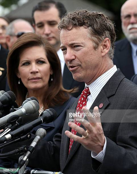Sen.Rand Paul speaks as U.S. Rep. Michele Bachmann and Sen. Ted Cruz listen during a news conference May 16, 2013 on Capitol Hill in Washington, DC....