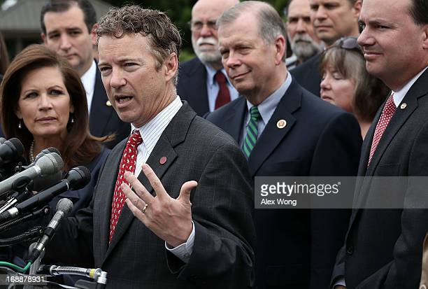 Sen.Rand Paul speaks as U.S. Rep. Michele Bachmann , Sen. Mike Lee and Sen. Ted Cruz listen during a news conference May 16, 2013 on Capitol Hill in...