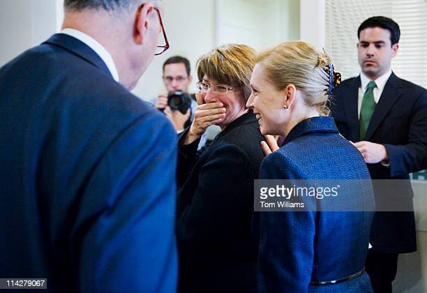 Sens Amy Klobuchar DMinn center has a word with Sen Kirsten Gillibrand DNY before a news conference in the Capitol to call on Congress to pass...