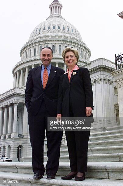 Sens Charles Schumer and Hillary Rodham Clinton on the steps on the Senate side of the US Capitol