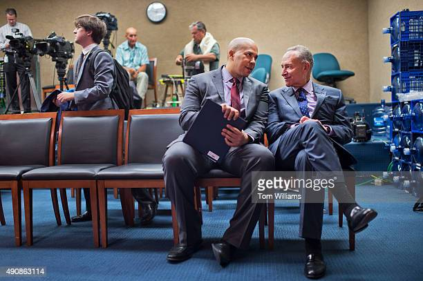 Sens Cory Booker DNJ left and Charles Schumer DNY talk after a news conference to introduce the Iran Policy Oversight Act of 2015 in the Capitol's...