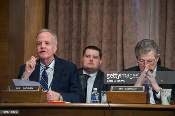 Sens Jerry Moran RKan and John Kennedy RLa are seen during a Senate Banking Housing and Urban Affairs Committee hearing in Dirksen Building on the...