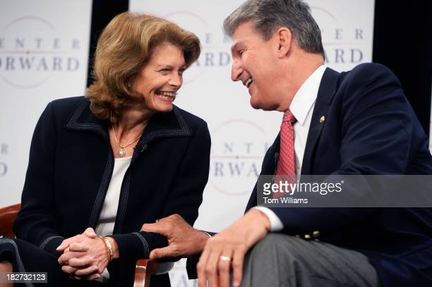 Sens Joe Manchin DWVa and Lisa Murkowski RAlaska share a laugh during a panel discussion at the Newseum on energy policy that was hosted by Center...