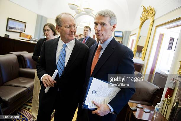 Sens. Lamar Alexander, R-Tenn., left, and Rob Portman, R-Ohio, conclude a news conference in the Senate Print Gallery on topics ranging from job...