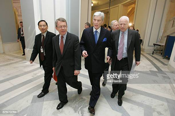 US Sens Mike DeWine John Warner and John McCain leave a bipartisan meeting with fellow senators where they reached a compromise to avoid a showdown...