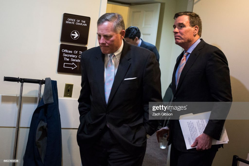 U.S. Sens. Richard Burr (R-NC) (L) and Mark Warner (D-VA) head to a news conference to provide an update on the committee's investigation of Russian interference in the 2016 election March 29, 2017 on Capitol Hill in Washington, DC. DC. The senators said that an unprecedented number of committee staff have been given access to information from the intelligence community during this investigation.