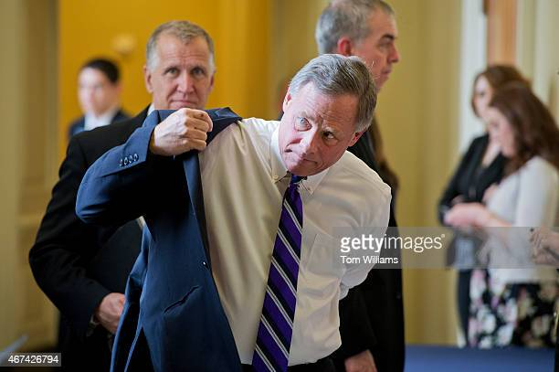 Sens Richard Burr RNC foreground and Thom Tillis RNC leave the Senate Policy luncheons in the Capitol March 24 2015