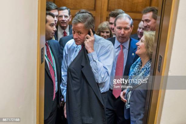 Sens Richard Burr RNC on phone Shelley Moore Capito RWVa right and other senators are seen in the senate subway before a vote in the Capitol on...
