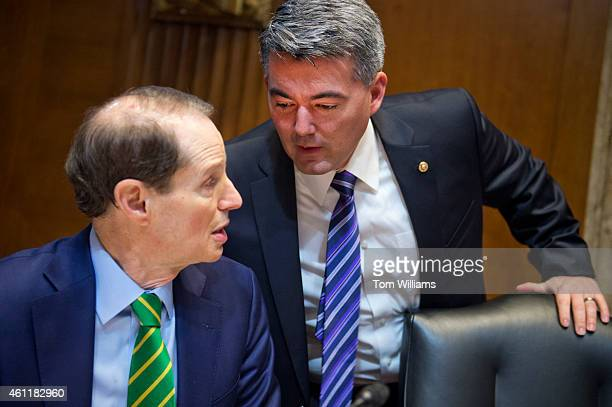 Sens Ron Wyden DOre left and Cory Gardner RColo confer before a Senate Energy and Natural Resources Committee markup in Dirksen Building on...