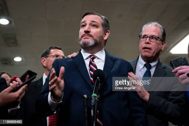 US Sens Ted Cruz and Mike Braun speak to the media during a dinner break in the Senate impeachment trial at the US Capitol January 27 2020 in...