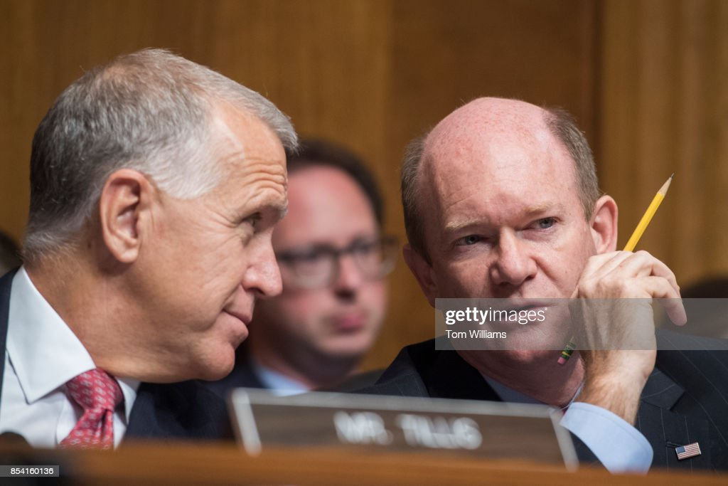 Image result for photos of senator chris coons and thom tillis