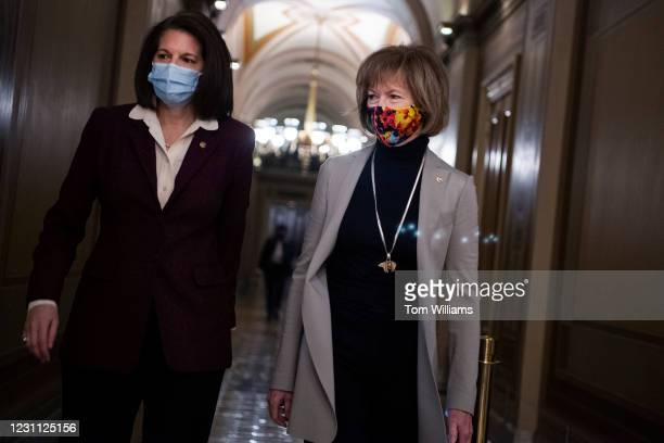 Sens. Tina Smith, D-Minn., right, and Catherine Cortez Masto, D-Nev., are seen in the Capitol during a break in the impeachment trial of former...