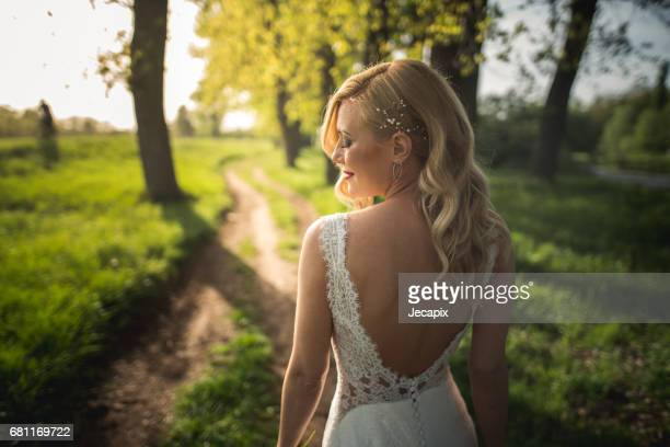 Sensual and elegant bride in the forest