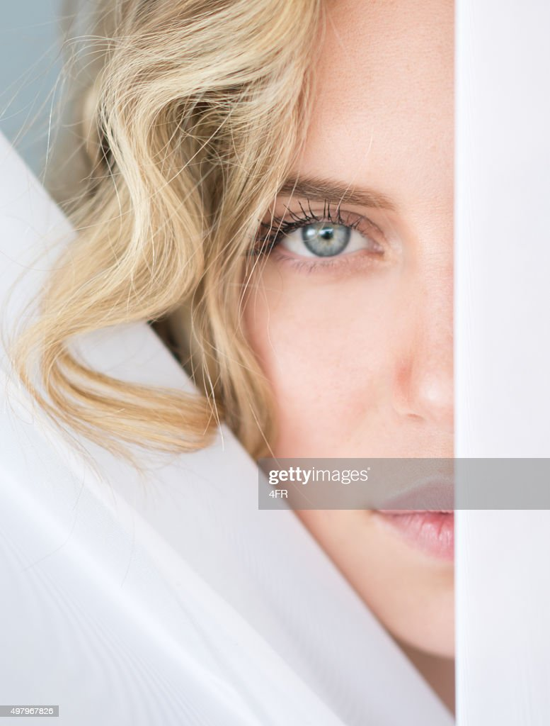 Sensual Beauty between the Curtains, Peeking : Stock Photo
