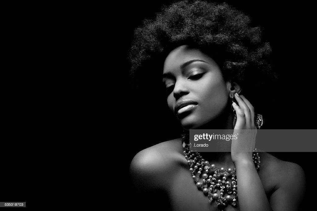 Sensual black woman wearing luxury necklace